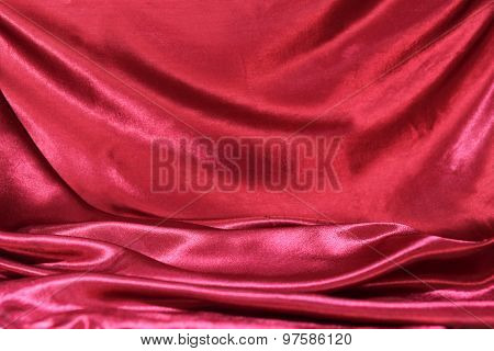 Undulating Folds Of The Fabric Of Dark Red Silk