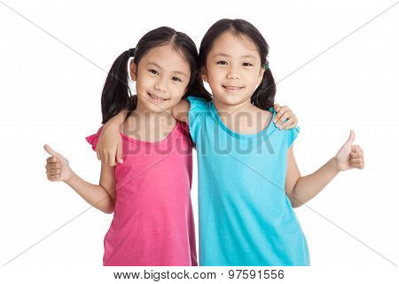 Happy Asian Twins Girls  Smile Show Thumbs Up
