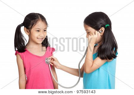 Happy Asian Twins Girls With Stethoscope