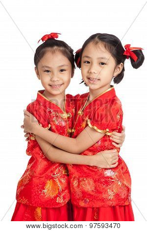Happy Asian Twins Girls In  Chinese Cheongsam Dress