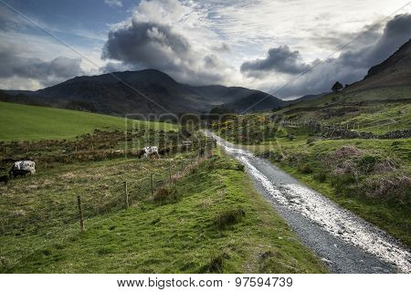 Beautiful Lake District Landscape Of Hills And Valleys On Stormy Spring Day