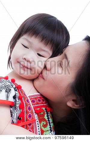 Mother Kissing Her Adorable Little Daughter Cheek, On White. Studio Shot
