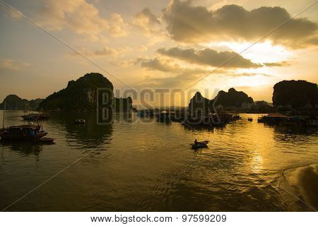 Beautiful seascape with boats in sunset in Halong bay