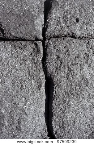 Volcanic Stone With Cracks Forming A Cross