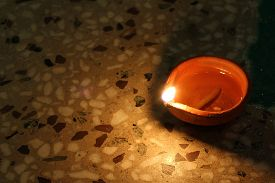 stock photo of diya  - earthen lamp - diya on floor removes the darkness and 