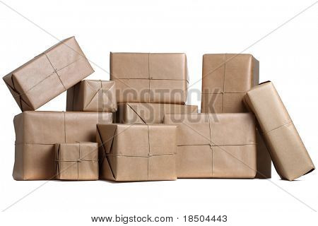 Isolated Parcels wrapped in brown paper
