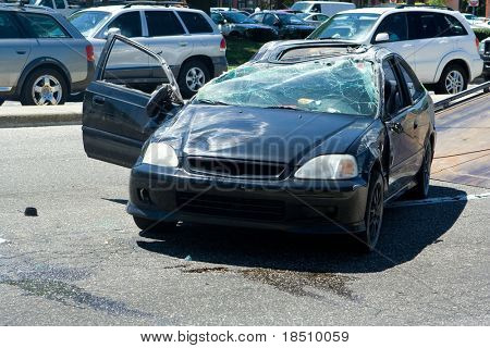 Traffic Accident resulting in a crushed Car