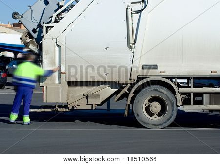 A White Garbage Truck with male worker