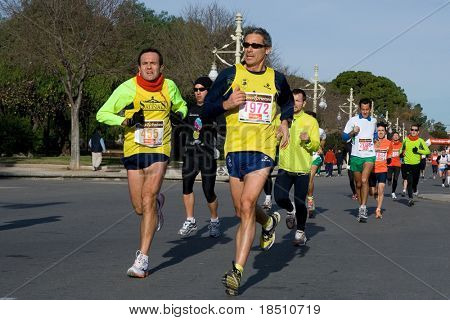 VALENCIA, SPAIN - JANUARY 10: Unidentified runners compete in the 10K Divina Pastora Valencia run on January 10, 2010 in Valencia, Spain.