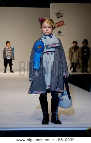 VALENCIA, SPAIN - JANUARY 23: FIMI Children's Winter Fashion Show with the designer Floc Baby on the runway in the Feria Valencia on January 23, 2010 in Valencia, Spain.