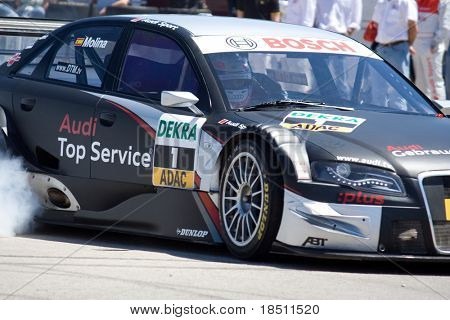 VALENCIA, SPAIN - MAY 16: 21 year old Spanish Driver Miguel Molina gives a demonstration in an Audi A4 DTM Edition in the streets of Valencia on May 16, 2010 in Valencia, Spain.