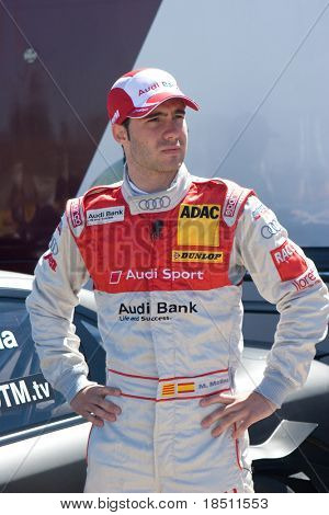 VALENCIA, SPAIN - MAY 16: To promote the DTM Valencia 2010 event, Spanish race car driver Miguel Molina of the Audi DTM Race Team meets with fans on May 16, 2010 in Valencia, Spain.