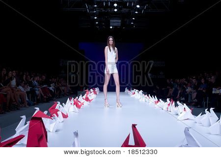 VALENCIA, SPAIN - SEPTEMBER 2: A model on the catwalk wears a Higinio Mateu design for the Valencia Fashion Week on September 2, 2010 in Valencia, Spain.