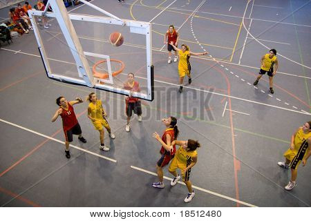 VALENCIA, SPAIN - NOV 14:  Women basketball teams, National & Technical University of Athens (yellow) plays the University of Crete in the EuroValencia games on November 14, 2010 in Valencia, Spain.