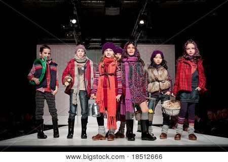 VALENCIA, SPAIN - JANUARY 21: unidentified children models at the FIMI Children's Winter Fashion Show with the designer Boboli in the Feria Valencia on January 21, 2011 in Valencia, Spain.