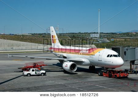 MADRID - APRIL 11: Executives of Iberia Airlines have a list of 12 airlines that they may buy that could create the largest airline in the world. An Iberia Aircraft on April 11, 2011 in Madrid, Spain.