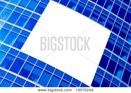 blue abstract crop of modern skyscraper with white placard in the center