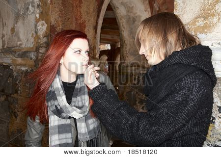 Young Man Gives A Cigarette To The Girl
