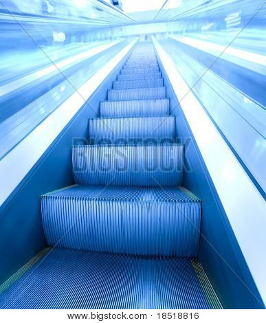 abstract blue moving escalator in business center