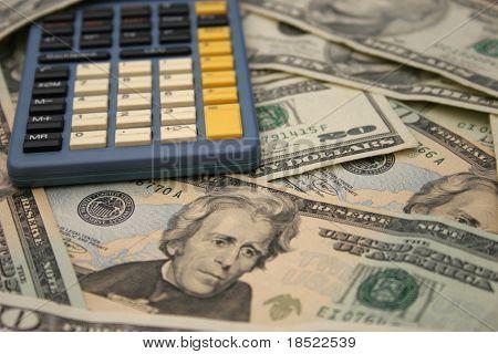 Calculator on a pile of cash
