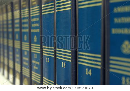Row of books, shallow dof, books in focus are blank for text on binding
