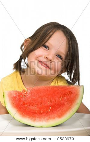 Little girl enjoying delicious watermelon, isolated over white