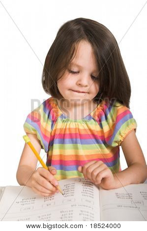 elementary school girl studying from book ,isolated over white