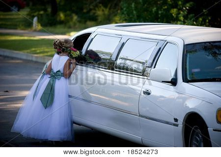 flower girl looking into the window of a limo, dreamy photo