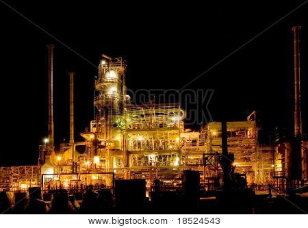 oil refinery lighting up the night sky