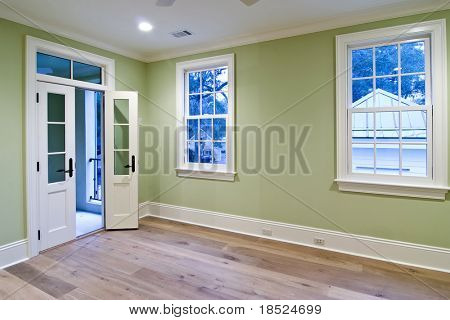unfurnished bedroom with open door to porch