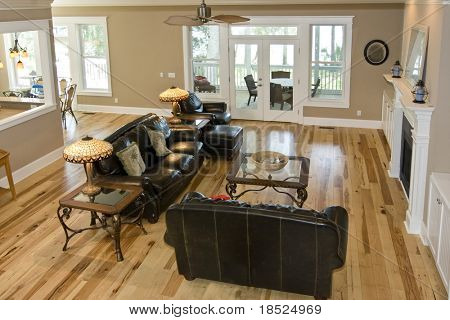 luxury livingroom with maple floors and leather furniture