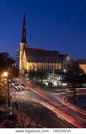 night scene of traffic and intersection in city with church