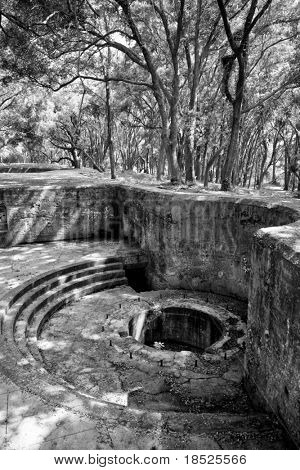 abandoned gun emplacement in the forest