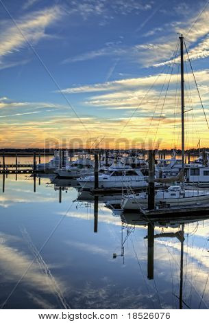 hdr image of boats in slip at sunset