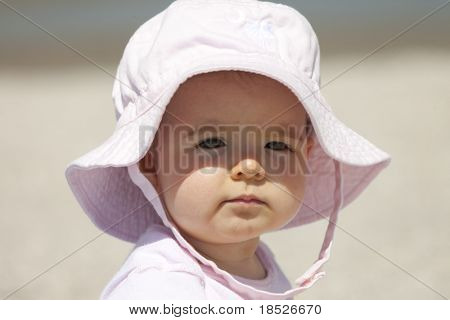infant girl in sun with sun hat