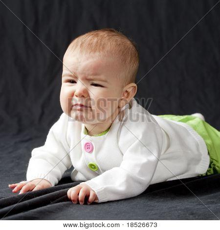 very unhappy baby, studio shot