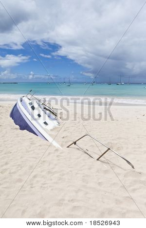 sailboat buried on a beach in Barbados