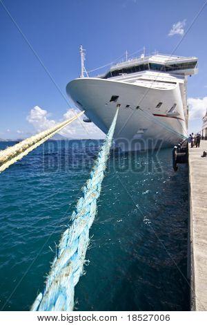 cruise ship in port, wide angle with focus on rope
