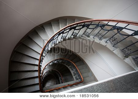 Spiral staircase with wooden handrail in art nouveau house