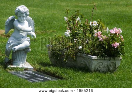 Angelic Statue Overlooking A Grave
