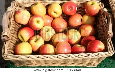 Apples In A Basket Outside A British Greengrocer Shop.