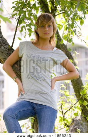 Girl Posing Near The Tree