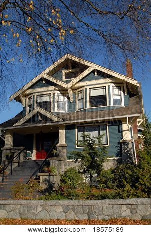 A Craftsman Style house in autumn.