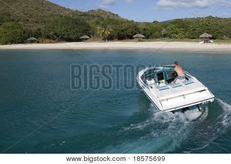 A speedboat in the turquoise waters of the Caribbean.