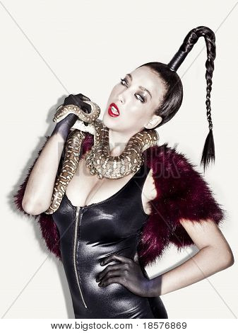 Edgy Fashion Model With Fur And Snake Shot In Studio