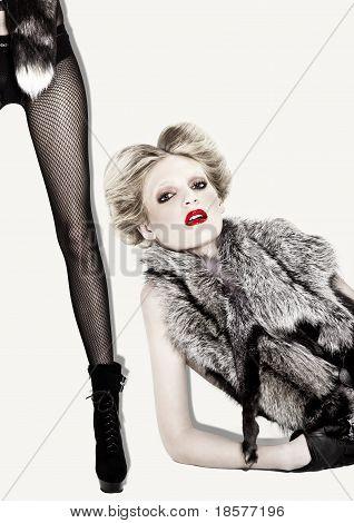Blond Edgy Fashion Model Shot On White In Studio