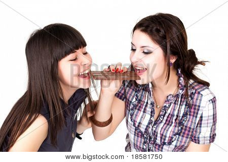 two girl biting a milk chocolate