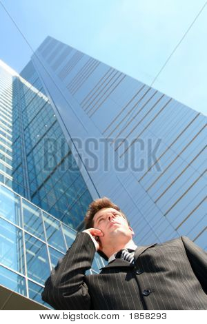 Businessman On Cellphone By Skyscraper