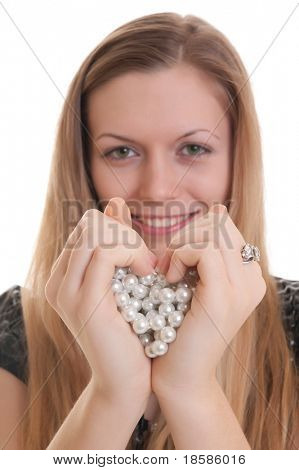 young beautiful girl showing heart symbol. soft focus on hands