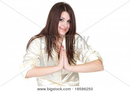 girl meditating on a white background in pyjamas